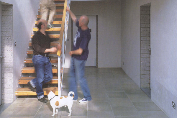 Bob (the dog), Peter, Marc and unknown at foot of stairs in a clear atrium