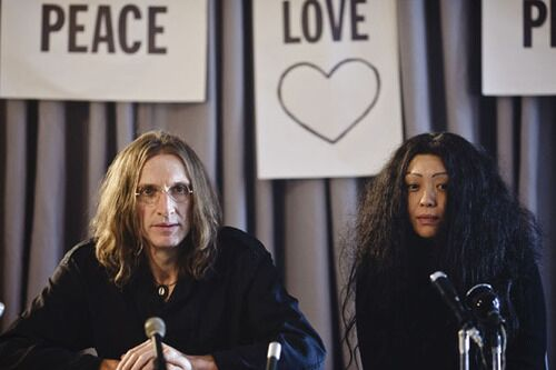 Film still of actors portraying John Lennon and Yoko Ono for 'Lennon Naked' by Robert Jones