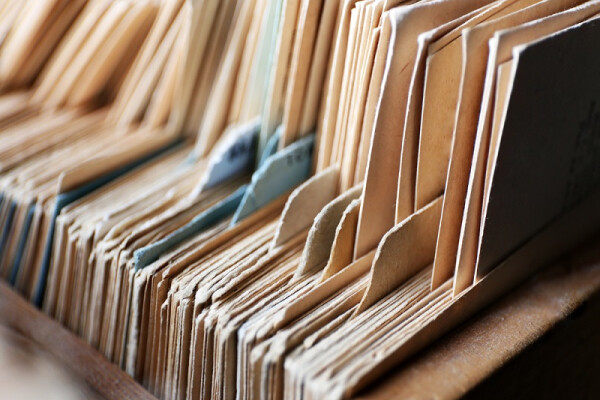 Close-up of a collection of paper files