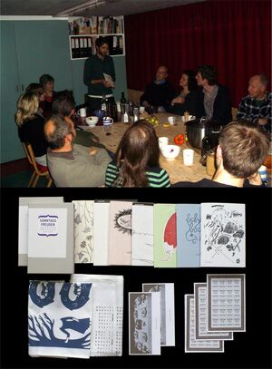 Roland in the kitchen with members and guests and his pamphlet series